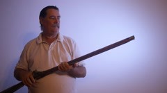 MAN WITH OLD MUSKET rifle gun replica Stock Footage