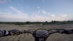Dirt biker pov of giant flock of birds while riding Stock Footage