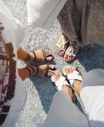 unique perspective of people's foot on the road as tourists while vacation tr - stock photo