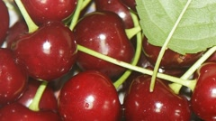 Fresh, ripe, juicy cherries pan shot Stock Footage