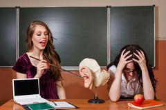 The student responds lesson. Teacher unhappy answer. - stock photo