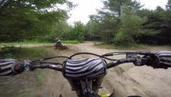 Pov chesty of motocross riders in rough whoop sections Stock Footage