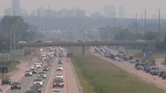 Haze and smog covers Toronto skyline and highway on hot summer day - stock footage