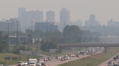 Haze and smog covers Toronto skyline and highway on hot summer day Stock Footage