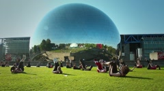 Physical exercise in front of La Géode - Science Museum, Paris Stock Footage