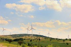 Wind power poles on a hill Stock Photos
