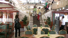Passengers walking up staircase inside a cruise boat Stock Footage