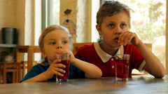 Children drink juice from glasses Stock Footage