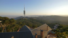 Great view of Tibidabo Hill and Collserola Tower in Barcelona Stock Footage