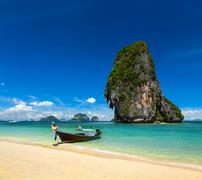 Thailand tropical vacation concept background - Long tail boat on tropical be - stock photo