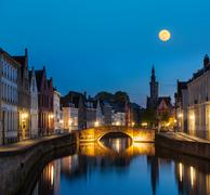 European medieval night city view background - Bruges (Brugge) canal in the e - stock photo