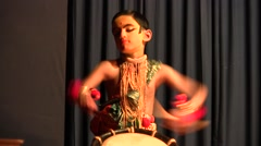 Child getting ready for Kathakali dances theatrical with tambour Stock Footage