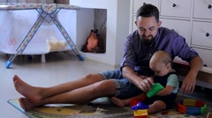 Young Father Playing with a Small Child in the Nursery. Stock Footage