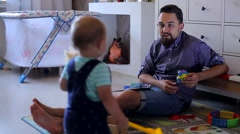 Small Child Goes to His Father in the Children's Room Stock Footage