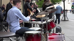 Drummer and young musicians chorus play music and sing. 4K Stock Footage