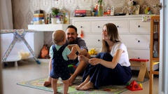 Young Parents and a Small Child  Stock Footage