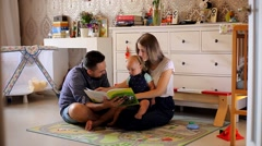 Young Parents Read the Book a Small Child in the Nursery Stock Footage