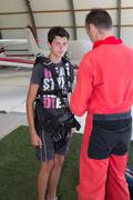 Preparation of parachutes for jumps in airdrome - stock photo