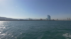 Hotel Vela seen in the distance on the seafront of Barcelona Stock Footage
