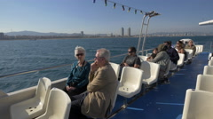 Tourists visiting Barcelona in a sightseeing cruise ship Stock Footage