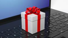 Stock Illustration of Gift box with red ribbon on black laptop keyboard