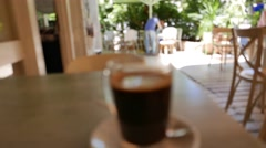 Stock Video Footage of 4K Cup Coffee with Restaurant Backdrop