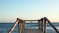 Wood bridge on the beach near the ocean. Stock Footage