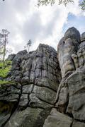 Male climber climbing rock - stock photo