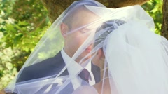 Romantic Kissing Under The Veil Of The Bride - stock footage