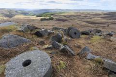 Old millstones, Stanage Edge, fine spring day, near Hathersage, Peak District - stock photo