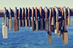 Rusty padlocks on a railing near the sea Stock Photos