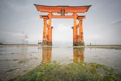 Long exposure in Miyajima, Floating Torii gate, low tide, Japan. Stock Photos