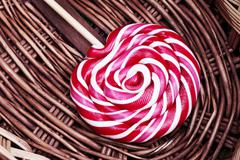 red and white large spiral lollipop - stock photo