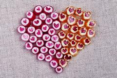 Lovely heart candy canes Stock Photos