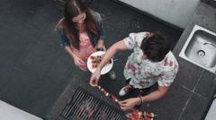 Friends preparing food Stock Footage