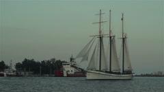 Tall Ship sails through city harbor at dusk 2 - stock footage
