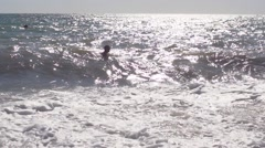 Seething wave sea sun backlight slow motion Stock Footage