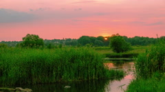 Sunsrise over river. 4K 4096x 2304 time lapse  without birds Stock Footage