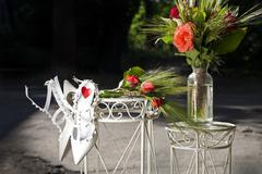 Wedding decorations red roses and white shoes Stock Photos