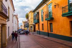 Very charming red paved street in old part of Bogota with beautiful yellow Stock Photos