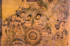 Ancient Buddhist temple the famous mural painting at Wat Phumin, a famous tem - stock photo
