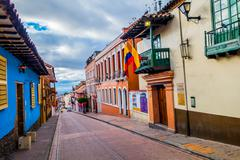 Stock Photo of Very charming street in old part of Bogota with small historical townhouses