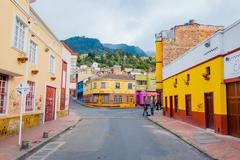 Charming neighbourhood of colorful two storey townhouses with a stone paved - stock photo