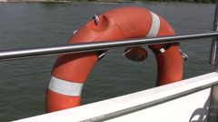 Generic clip of a rubber life ring on the side of a moving ship Stock Footage
