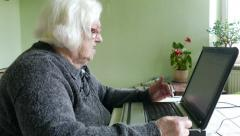 Angry old woman and computer - stock footage