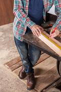 Carpenter measuring Stock Photos