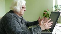 Angry old woman and computer Stock Footage