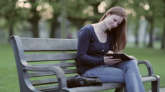 Believer Reads the Bible in a Park - stock footage