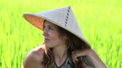 Portrait girl in straw hat against the backdrop a rice field in Bali, Indonesia Stock Footage