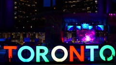 Toronto sign in Nathan Phillips Square celebrating the PanAm games Stock Footage